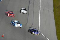#39 Crown Royal Porsche/Coyote, #01 Ganassi Racing Lexus/Riley of Scott Pruett & Memo Rojas and the #99 GAINSCO/Bob Stallings Racing Pontiac/Riley of Jon Fogarty & Alex Gurney