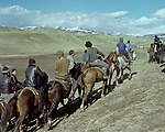 Participants in the game ulak, which runs on holidays, leaving their villages after their game. Ulak Tartysh is a traditional horseback game played in Kyrgyzstan with the body of a dead goat. Kyrgyzstan. 2013