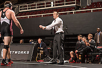 STANFORD, CA - January 18, 2015: Coach Ray Blake of the Stanford Cardinal wrestling team during a meet against Cal Poly at Maples Pavilion. Stanford won 22-13.