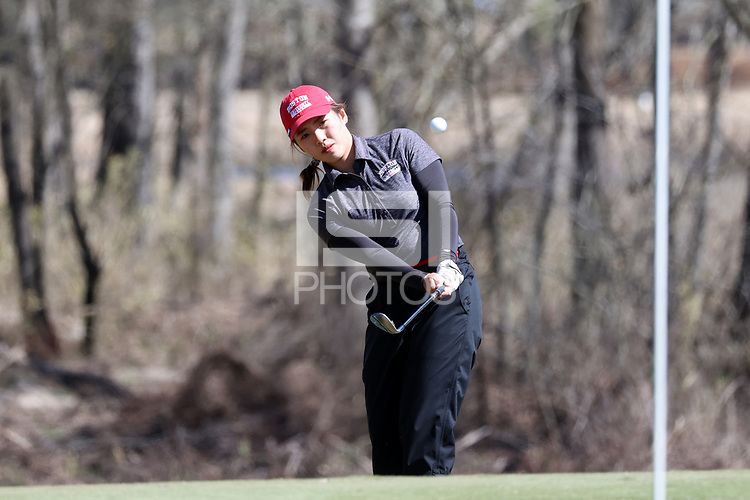 WALLACE, NC - MARCH 09: Zhangcheng Guo of Boston University chips onto the green on the 11th green on the River Course at River Landing Country Club on March 09, 2020 in Wallace, North Carolina.