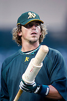 Travis Buck of the Oakland Athletics during batting practice before a game from the 2007 season at Angel Stadium in Anaheim, California. (Larry Goren/Four Seam Images)