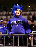 CHARLOTTESVILLE, VA- NOVEMBER 12: A Duke Blue Devils fan watches a play during the game against the Virginia Cavaliers on November 12, 2011 at Scott Stadium in Charlottesville, Virginia. Virginia defeated Duke 31-21. (Photo by Andrew Shurtleff/Getty Images) *** Local Caption ***