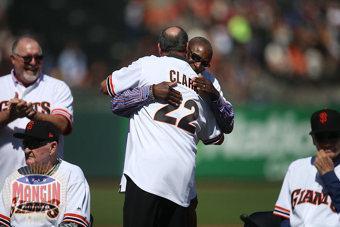 SAN FRANCISCO, CA - AUGUST 11:  Former San Francisco Giants player Will Clark hugs Dusty Baker after hearing his #22 will be retired next season during a ceremony honoring the 1989 Giants during a 30 year team reunion before the game between the Philadelphia Phillies and San Francisco Giants at Oracle Park on Sunday, August 11, 2019 in San Francisco, California. (Photo by Brad Mangin)