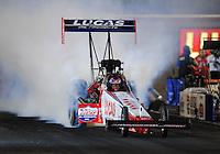 Oct. 31, 2008; Las Vegas, NV, USA: NHRA top fuel dragster driver Morgan Lucas does a burnout during qualifying for the Las Vegas Nationals at The Strip in Las Vegas. Mandatory Credit: Mark J. Rebilas-