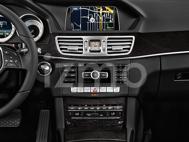 Stereo audio system close up detail view of a 2014 Mercedes E350 Sedan