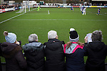 Stafford Rangers 2 Chasetown 1, 26/12/2015. Marston Road, Northern Premier League. Five  women spectators watching the first-half action at Marston Road, home of Stafford Rangers as they took on local rivals Chasetown in a Northern Premier League first division south fixture. The club has played at Marston Road since 1896 and achieved prominence in the 1970s and 1980s as one of England's top non-League teams. League leaders Stafford won this match 2-1, despite having a man sent off, watched by a season's best attendance of 978. Photo by Colin McPherson.
