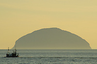 A fishing trawler leaving Girvan Harbour with Ailsa Craig on the horizon, Girvan, Ayrshire<br /> <br /> Copyright www.scottishhorizons.co.uk/Keith Fergus 2011 All Rights Reserved