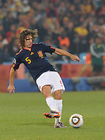 Carles Puyol swings the ball out to his right flank. Spain won Group H following a 2-1 defeat of Chile in Pretoria's Loftus Versfeld Stadium, Friday, June 25th, at the 2010 FIFA World Cup in South Africa..