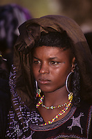 Akadaney, Niger, Africa - Fulani Wodaabe Woman at Geerewol, watching Male Dancers in the Male Beauty Contest.