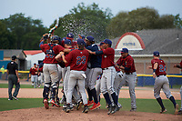 Mahoning Valley Scrappers players, including Jonathan Teaney (30), Jason Rodriguez (20), Gian Paul Gonzalez (4), Nolan Jones (10), Francisco Perez (jacket), Ernie Clement (24), and James Karinchak (23) celebrate winning the division title during the second game of a doubleheader against the Batavia Muckdogs on September 4, 2017 at Dwyer Stadium in Batavia, New York.  Mahoning Valley defeated Batavia 6-2 to clinch the Pinckney Division Title.  (Mike Janes/Four Seam Images)
