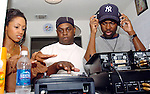 Actor/Comedian Chris Rock and his wife Malaak check out DJ equipment of  Hurricane Katrina evacuee Ronald Williams,center, while on a visit to the Bonita House in Houston,Texas Thursday Sept. 29,2005.