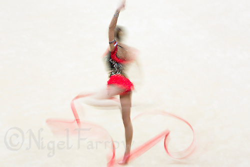 11 AUG 2012 - LONDON, GBR - Joanna Mitrosz (POL) of Poland performs her ribbon routine during the 2012 London Olympic Games Individual All-Around Rhythmic Gymnastics final at Wembley Arena in London, Great Britain (PHOTO (C) 2012 NIGEL FARROW)
