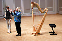 USA International Harp Competition Founder and Artistic Director Susann McDonald reacts to applause from the audience before a laureate recital by harpist Katherine Siochi during the 11th USA International Harp Competition at Indiana University in Bloomington, Indiana on Friday, July 5, 2019. (Photo by James Brosher)