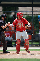 GCL Phillies West catcher Abrahan Gutierrez (3) throws back to the pitcher in front of home plate umpire Ryne Sigmon during a game against the GCL Blue Jays on August 7, 2018 at Bobby Mattick Complex in Dunedin, Florida.  GCL Blue Jays defeated GCL Phillies West 11-5.  (Mike Janes/Four Seam Images)