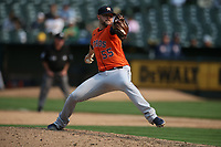 OAKLAND, CA - SEPTEMBER 25:  Ryan Pressly #55 of the Houston Astros pitches against the Oakland Athletics during the game at the Oakland Coliseum on Saturday, September 25, 2021 in Oakland, California. (Photo by Brad Mangin)