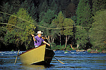 Bill Wilson fly fishing from his drift boat on the McKenzie River; Cascade Mountains, Lane County, Oregon..#5083-2419