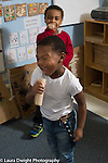 Education preschool 3-4 year olds pretend play two boys singing with musical instruments made from blocks