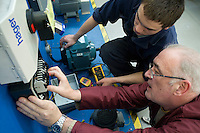 Visually inspecting the electrical wiring for an electrical reversing starter.  Apprentice engineering students at Kingston College..
