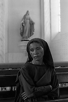 Woman in church, Catholicism. Pilgrimage to Juazeiro do Norte city in Ceara State, Northeastern Brazil.