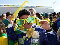 A Brazil fan wearing an Elvis costume outside the Stadium Arena Corinthians
