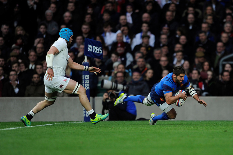 Sébastian Tillous-Borde of France dives over to score a try as James Haskell of England gives chase
