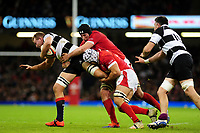 Barbarians Angus Cottrell is tackled by Wales Ollie Griffiths during the International friendly match between Wales and Barbarians at the Principality Stadium in Cardiff, Wales, UK. Saturday 30 November 2019.