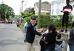 NAUGATUCK, CT - 26 MAY - 052818JW03.jpg --  DAV Commander and Vietnam Vetran David Opotzner passes out American flags to spectators along North Main Street during the Naugatuck Memorial Day Parade Monday morning. Jonathan Wilcox Republican-American
