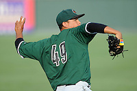 Starting pitcher Luis Ysla (49) of the Augusta GreenJackets warms up before a game against the Greenville Drive on Thursday, July 10, 2014, at Fluor Field at the West End in Greenville, South Carolina. (Tom Priddy/Four Seam Images)