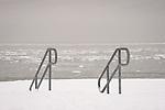 Middle Beach Road. Madison Beach railings to beach in snow. Long Island Sound.