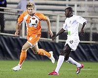 Brad Rusin 324 Of the Carolina Railhawks closes in on Kendall Jagdeosingh #10 of the Puerto Rico Islanders during the second leg of the USSF-D2 championship match at WakeMed Soccer Park, in Cary, North Carolina on October 30 2010. The game ended 1-1, Puerto Rico won on overall goals 3-1.