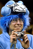 A North Carolina fan dressed up with a Tar Heel hat snaps photos during the NCAA Basketball Men's East Regional at Time Warner Cable Arena in Charlotte, NC.