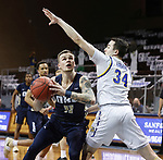 SIOUX FALLS, SD - MARCH 8: Carlos Jurgens #11 of the Oral Roberts Golden Eagles drives on Alex Arians #34 of the South Dakota State Jackrabbits during the Summit League Basketball Tournament at the Sanford Pentagon in Sioux Falls, SD. (Photo by Richard Carlson/Inertia)