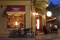 Moped outside restaurant in Gamla Stan, Old Town, at night.