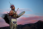 Native American at sunset with drum