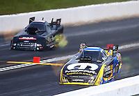 May 22, 2016; Topeka, KS, USA; NHRA funny car driver Matt Hagan (right) defeats Brian Stewart during the Kansas Nationals at Heartland Park Topeka. Mandatory Credit: Mark J. Rebilas-USA TODAY Sports