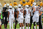 Players assemble in the center of the  field for the coin toss before the game between the Oklahoma State Cowboys and the Baylor Bears at the McLane Stadium in Waco, Texas.