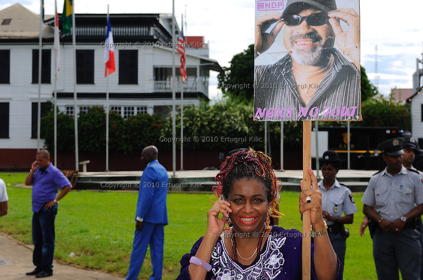 NDP (National Democratic Party of Suriname) supporters are acting at front of De Nationale Assemblée (DNA) / The National Assemble of Suriname after Desi Bouterse (Desiré Delano Bouterse) won the presidential election.....Desi Bouterse (Desiré Delano Bouterse) chosen as new president of Suriname by De Nationale Assemblée (DNA) / The National Assemble of Suriname. He took 36 votes of 51 as leader of the Mega Combination. ....Robert_Ameerali the head of KKF (Kamer van Koophandel en Fabrieken) / Chamber of Commerce and Industry also selected as Vice President.....Desi Bouterse (Desiré Delano Bouterse) will sworn at 3 August 2010