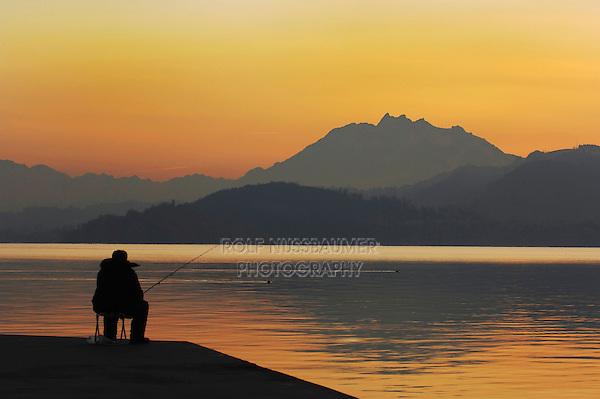 Fisherman at sunset,  Zug, Switzerland