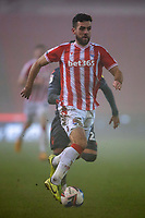 29th December 2020; Bet365 Stadium, Stoke, Staffordshire, England; English Football League Championship Football, Stoke City versus Nottingham Forest; Tommy Smith of Stoke City in the fog