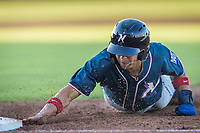 Northwest Arkansas Naturals outfielder Blake Perkins (3) dives back to first base against the Wichita Wind Surge at Riverfront Stadium on July 9, 2021 in Wichita, Kansas. (William Purnell/Four Seam Images)