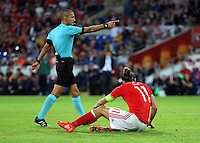 (L-R) Match referee Liran Liany points to the player that brought Gareth Bale of Wales down thus awarding a penalty during the 2018 FIFA World Cup Qualifier between Wales and Moldova at the Cardiff City Stadium on September 5, 2016 in Cardiff, Wales.