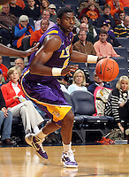 Jan. 2, 2011; Charlottesville, VA, USA; LSU Tigers forward Malcolm White (5) dribbles the ball during the game against the Virginia Cavaliers at the John Paul Jones Arena. Mandatory Credit: Andrew Shurtleff-