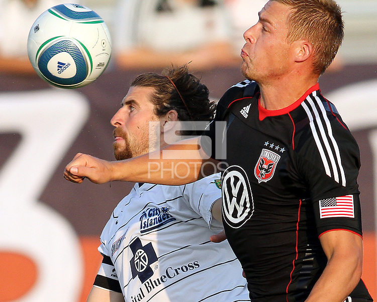 Danny Allsopp #9 of D.C. United clashes with Dustin Bixler #3 of the Harrisburg City Islanders during a US Open Cup match at the Maryland Soccerplex on July 21 2010, in Boyds, Maryland. United won 2-0.