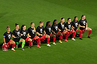 ORLANDO CITY, FL - FEBRUARY 18: Canada Starting XI kneel during the National Anthem prior to a game between Canada and USWNT at Exploria stadium on February 18, 2021 in Orlando City, Florida.