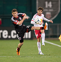 Perry Kitchen (23) of D.C. United tries to stop the cross of Juninho (8) of New York Red Bulls during the game at RFK Stadium in Washington, DC.  New York Red Bulls defeated D.C. United, 2-0.