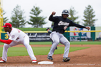 Everett Williams #45 of the San Antonio Missions steps back on first base during a pickoff attempt during a game against the Springfield Cardinals at Hammons Field on April 16, 2013 in Springfield, Missouri. (David Welker/Four Seam Images)
