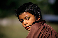 Portrait of a Guatemalan boy looking over his shoulder at a refugee camp, Chiapas, Mexico.