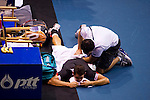 BANGKOK, THAILAND - OCTOBER 02:  Guillermo Garcia-Lopez of Spain receives medical attendtion during his match against compatriot Rafael Nadal during the Day 8 of the PTT Thailand Open at Impact Arena on October 2, 2010 in Bangkok, Thailand. Photo by Victor Fraile / The Power of Sport Images
