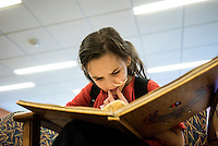 Beatrice Lipp reads a book sitting in a chair in hospital. She is an 8 year old with ulcerative colitis, a form of inflammatory bowel disease (IBD) which causes inflammation and ulcers in the colon. She has been in and out of Hospitals for the last 5 years.  Now at Boston Children's Hospital, she is part of a social robotic experiment between Boston's Children Hospital and the Massachusetts Institute of Technology (MIT). The goal of the experiment is to determine whether a so called 'Huggable' teddy bear, a social robotic stereotype, can have therapeutic value for children who have to endure long hospital stays. The bear's talking and movements are remotely controlled by Hospital Staff from outside of the room.