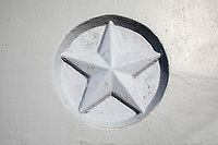 Close up of a Texas Lone Star, raised icon in bridge over pass in Austin, Texas